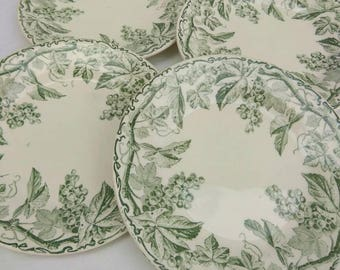 Four vintage French tea plates. Green transfer printed ironstone side plates