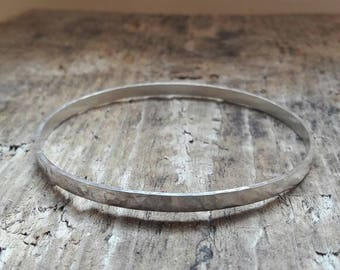 Hammered textured sterling silver bangle.