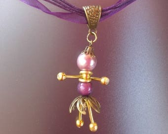 Doll, purple, gold and bronze pendant necklace