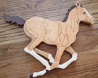 Running Colt Intarsia Wall Hanging, Horse is light brown with white legs and dark brown mane