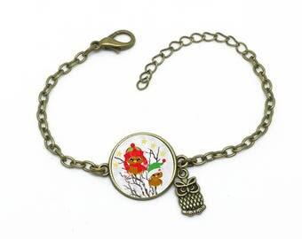 """Bracelet """"Bébés oiseaux """", image sous cabochon résine ,monture couleur bronze,ref bA 23"""