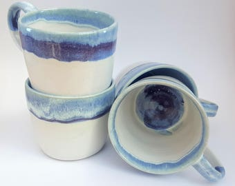 Hand thrown set of 4 mugs