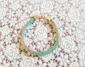Miyuki beads crochet bracelet. Fresh green with pink gold.
