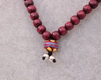 Wooden necklace with flower pendant and silver