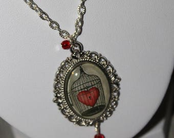 """Necklace and cabochon glass """"Heart in cage"""""""