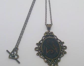 Nature theme bronze cameo necklace