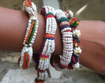 Four beautiful vintage Banjara tribal glass beaded bangles with button fastening from Gujarat Free shipping.