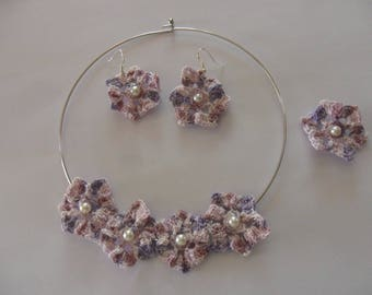 set consists of a necklace and earrings + ring