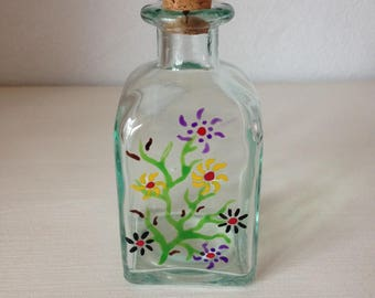 small decorative glass bottle with creative flowers