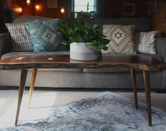 Mid-century Modern live edge coffee table with wooden legs