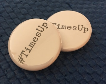 "Set of two. #TimesUp  1.25"" pinback buttons."