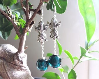 CARP earrings and Pearl handcrafted credit to the tin foil.