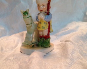 Vintage figurine little boy with green horse