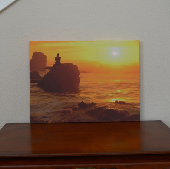 Lighted Canvas Painting with Glowing Ocean Sunset. Lighted by nicely embedded LED lights. Looks really beautiful.