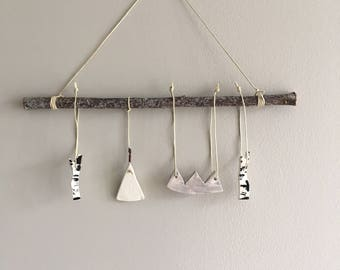 Mountain camping themed mobile hand made and hand painted clay pieces hung on branch