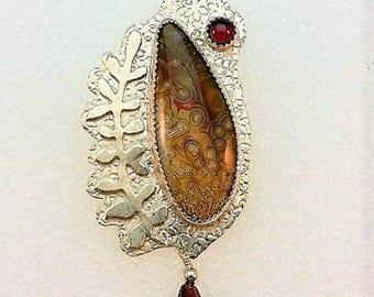 Multigemstone handcrafted sterling silver pendant with laguna lace agate, garnet cabochon, garnet bead, fern leaf applique