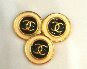 3 black and white vintage Chanel Buttons