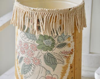 Fabric covered waste bin with fringe detail