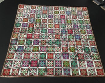 Colorful embroidered tablecloth on canvas.