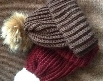 Soft and warm winter pompom hat .