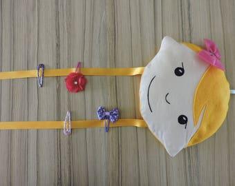 Tie bars hanging blonde doll