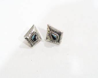 Native american navajo pierced earrings with inlay surrounded by etching