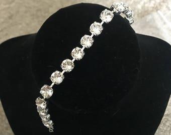 Shiny silver setting with clesr Swarovski crysta stone bracelet