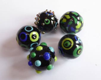 Glass lampwork bead set made in black decorated with bright colors.