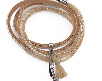Wrap bracelet with tassel and feather accents with magnetic closure