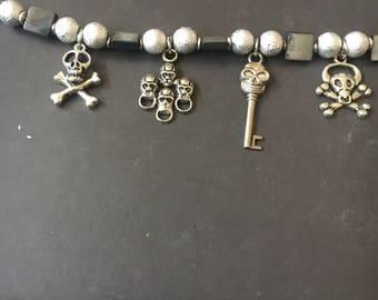 Silver skulls charm bracelet