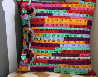Bright printed tape measure floral cushion