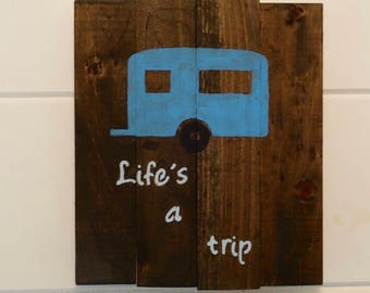 """Vintage travel trailer wooden sign. """"Life's a trip"""""""
