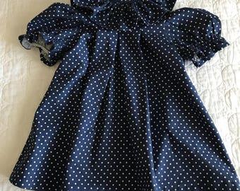 Navy polkadot dress.