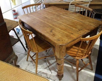 Solid wood table with turned legs