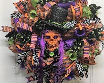 Glittered Orange Skull Halloween Mesh Wreath