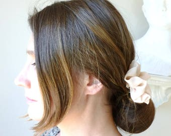 Nude in silky chiffon flower clip, hair, retro, romantic and Bohemian.