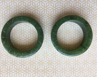2 inch Jade Eyelets. With hatch design carvings on face