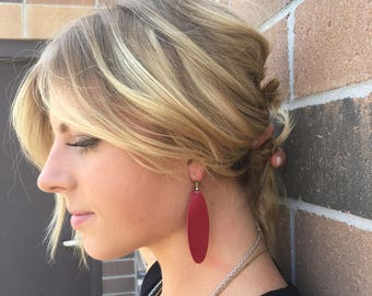 cranberry long oval leather earrings