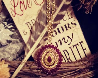 Large red and gold tone pendant and chain