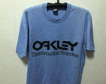 Vintage 90s Oakley Shirt Size XL Free Shipping Oakley Thermonuclear Protection 50 cotton Screen Stars Best Sunglasses Genuine Software Surf