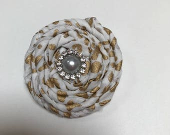 Gold and white rolled fabric flower