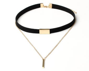 Black choker with gold detail and pendant