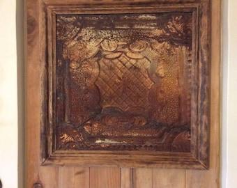 Antique tin ceiling tile framed