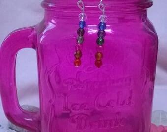 Rainbow coloured earrings.