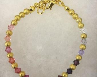 Gold beaded swarovski beaded bracelet