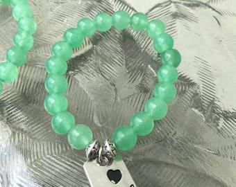 Green gemstone rock with a charm bracelet