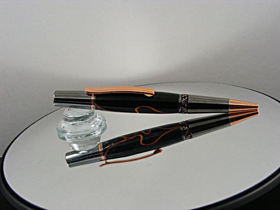 Handcrafted Ballpoint Pen in Black TI and Copper with Orange Ribbons on Chocolate Acrylic
