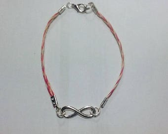 Infinity bracelet with pink and beige braided link