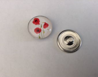 Snap closure in red poppy flower pattern on white background
