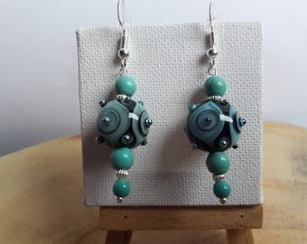 Pair of earrings designer Lampwork, turquoise tinted howolites over 925 sterling silver beads